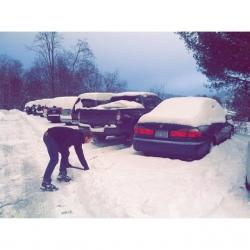 student shoveling snow
