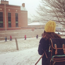 student outside in the snow