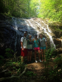 group at a waterfall after a hike
