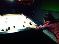 girl playing pool