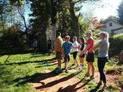 group playing softball outside