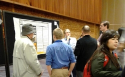 student with poster presentation